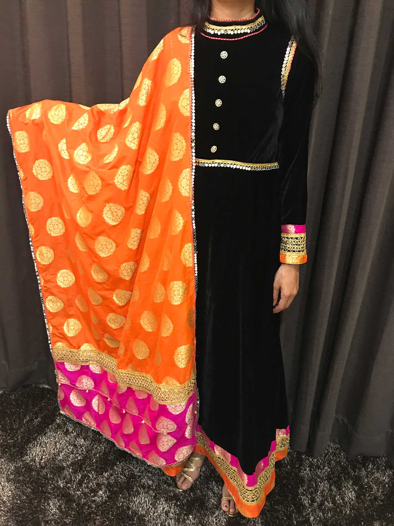 A Velvet Dress in the Aristrocatic Black with a Classy Combo of Orange and Pink Banarasee Dupatta in Pure Silk