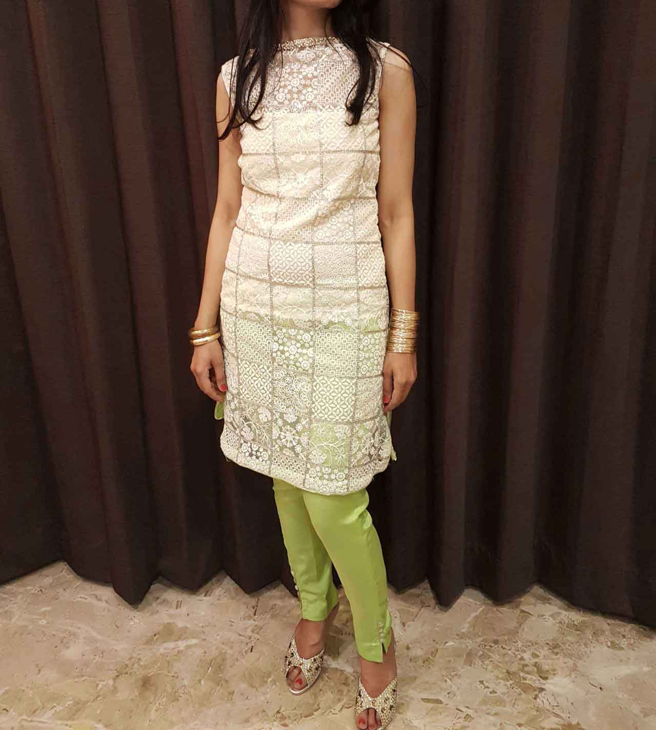 An Embroidered Kurti in Silver Sequence with a Boat Neck in Pearls and Kundans paired up with Cigarette Pants
