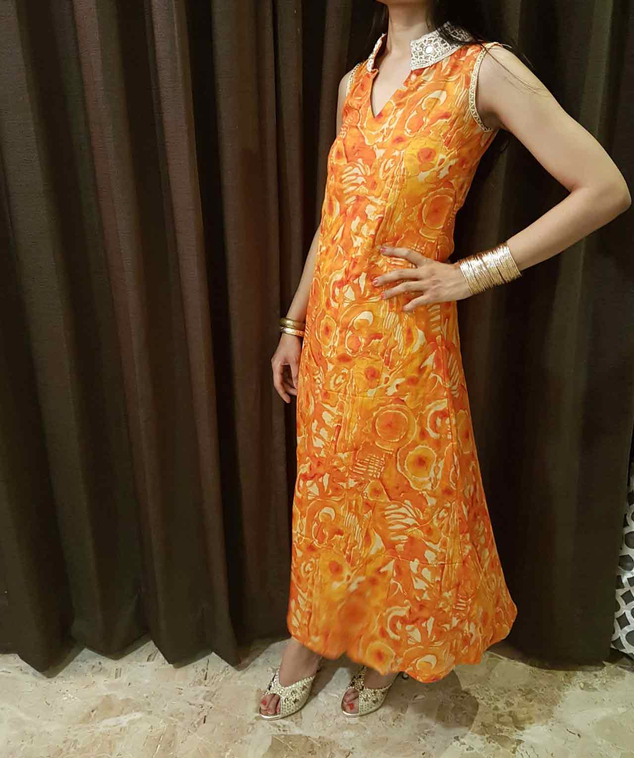 An Orange Cotton Dress with Mirror Worked Neck