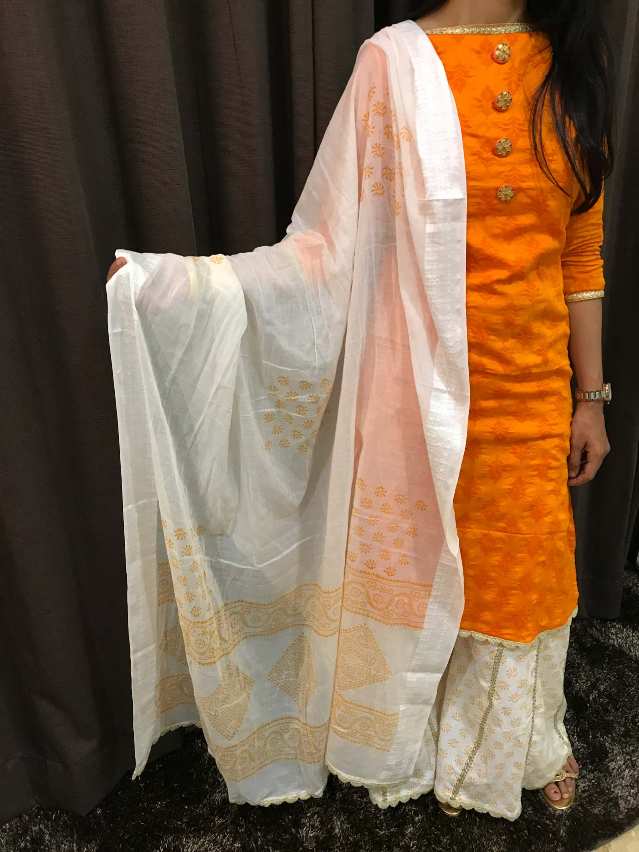 A Sun hued Orange Cotton Dress with Gota Patthi Buttons paired up with a Kali Palazzo