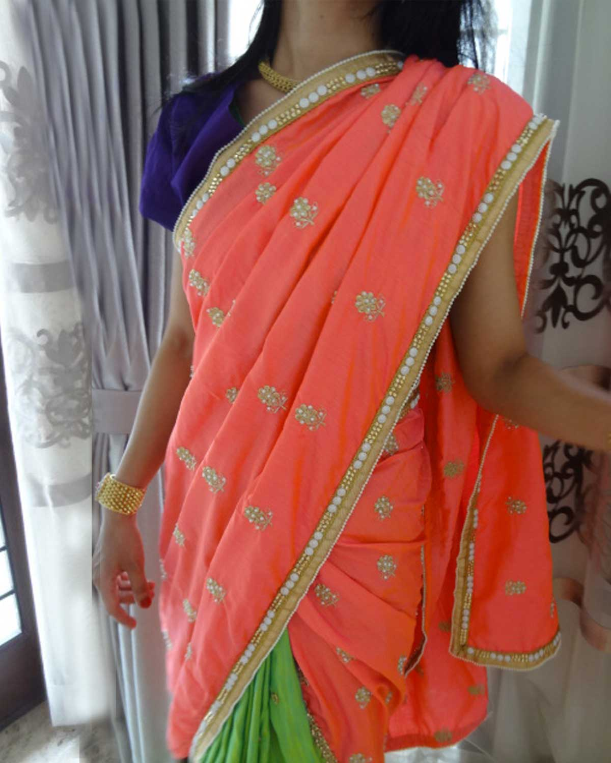 A Silk saree in Peach and Green Combo with Pearl and Mirror Butis and Pearl and Kundan Border