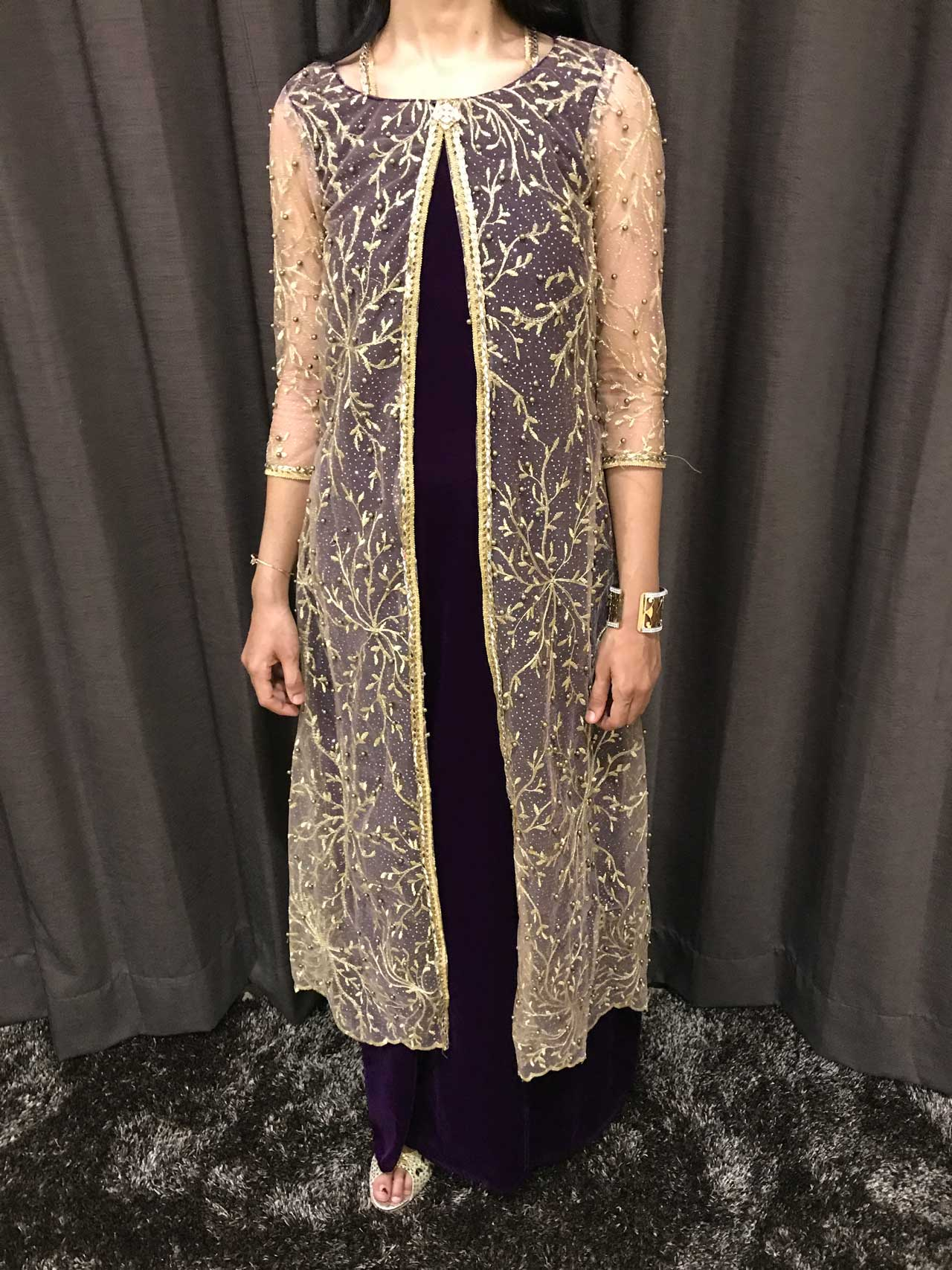 A Purple Velvet Gown with Golden Pearl and Mirror Embellishments